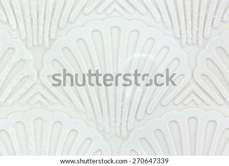 A very close view of an attractive shell pattern bathtub mat. - stock photo