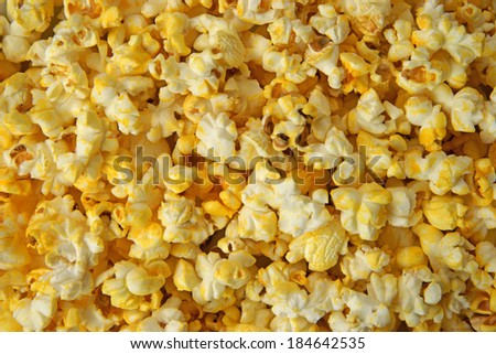 A very close view of buttered popcorn. - stock photo