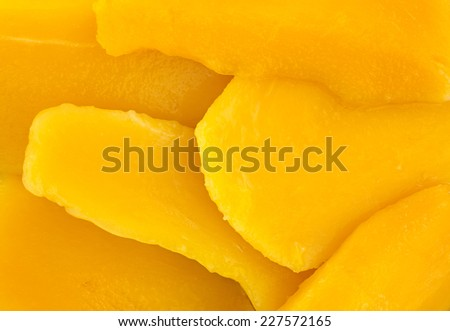 A very close view of canned mango slices. - stock photo