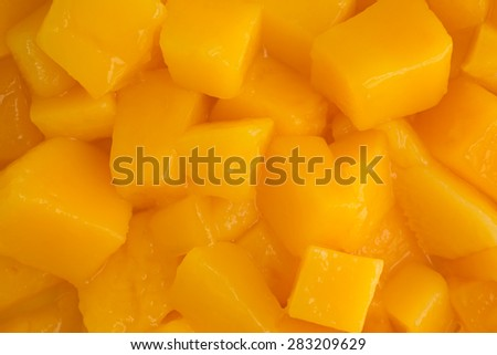 A very close view of diced canned mangoes. - stock photo
