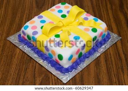 A very colorful birthday cake, decorated with eye-popping colors. - stock photo