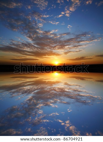 A Very Colorful Mythical Sunset Over Still Water. This Is A Digital Composite Image - stock photo