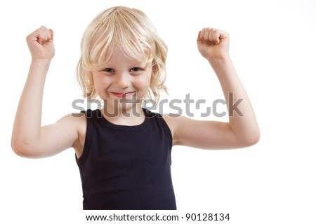 A very cute blond boy smiling and flexing his muscles - stock photo