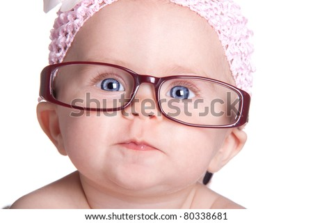 A very cute image of an adorable baby wearing glasses.  This baby is already saving for her college fund! - stock photo