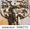 A very detailed rock carving situated above the doorway of an old building in Malmo, Sweden. - stock photo