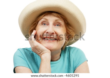 A very excited senior lady in a straw sun hat.  Isolated on white. - stock photo