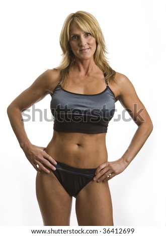 A very fit mature woman in a work out outfit