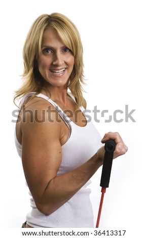 A very fit mature woman working out