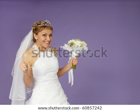 A very happy bride on a purple background - stock photo