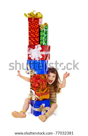 A very happy child enjoys on holiday gifts isolated on white background - stock photo
