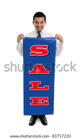 A very happy confident businessman or salesman holding a SALE banner sign - stock photo