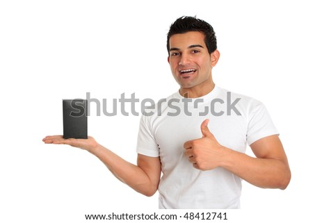 A very happy salesman or consumer holding a product and giving a thumbs up sign.   eg great, approval, success. - stock photo