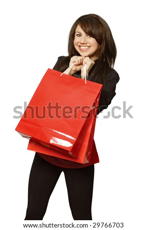 A very happy shopping girl holding bags and filled with glee. - stock photo