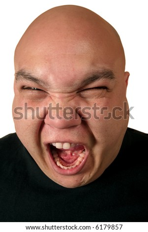 A very ill-tempered male yelling about something. - stock photo