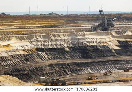 A very Large excavator at work in one of the world's largest lignite (brown coal) mines  - stock photo