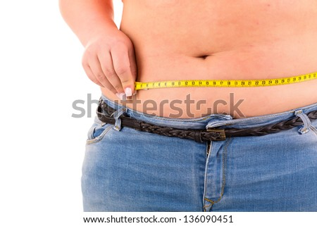 A very large woman measuring her body - stock photo
