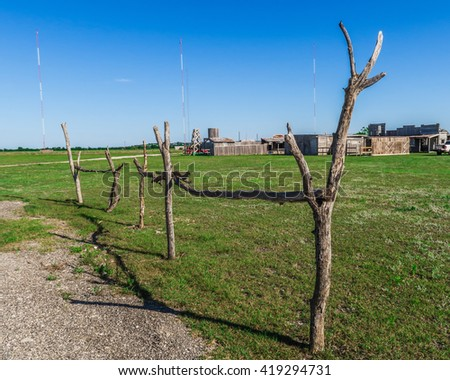 a very makeshift railing made of tree branches - stock photo