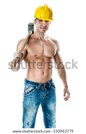 a very muscular and handsome manual worker with a sludgehammer and a yellow helmet isolated over white - stock photo