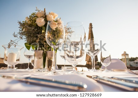 A very nicely decorated wedding table with plates and serviettes. - stock photo