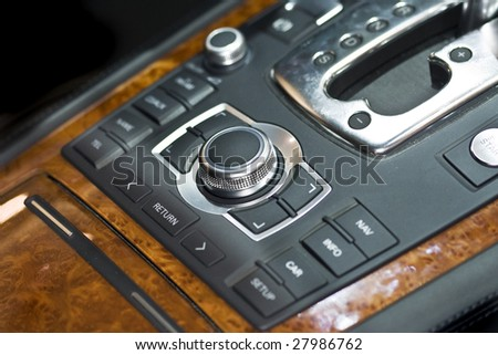 A very nicely, wood-trim automobile central console