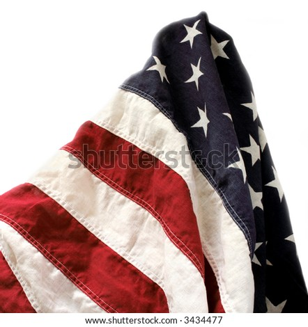 a very old American flag isolated on white - stock photo