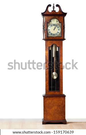 A very old grandfather clock stood the test of time. - stock photo