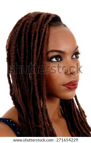 A very pretty young African American woman in profile closeup shoot,  looking away, isolated for white background.