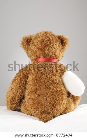 a very sad teddy bear with an amputated claw