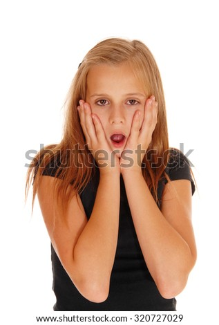 A very scared looking young girl with her mouth open and her hands on