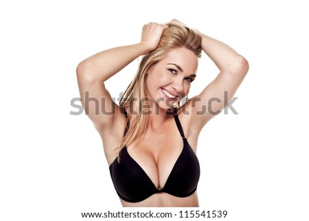 A very sexy blond woman wearing a black bra on a white background. Sexy blond woman. - stock photo
