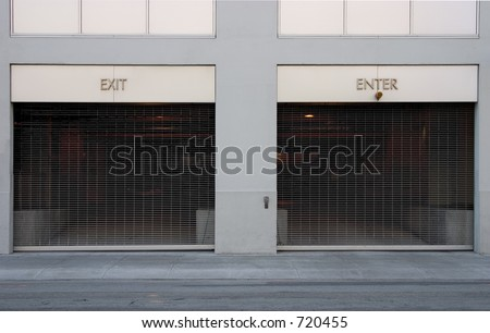 "A very simple image of two car ports; one marked ""Exit"", the other ""Enter""."