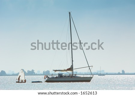 a very small and a big sailboat