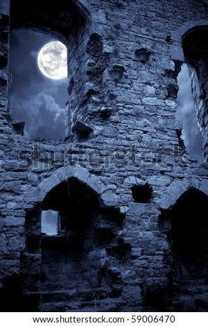 A very spooky Halloween castle in the moonlight