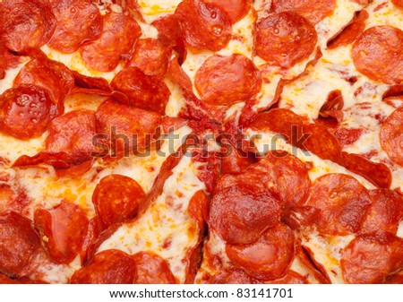 A very tempting image of a delicious pepperoni pizza. - stock photo