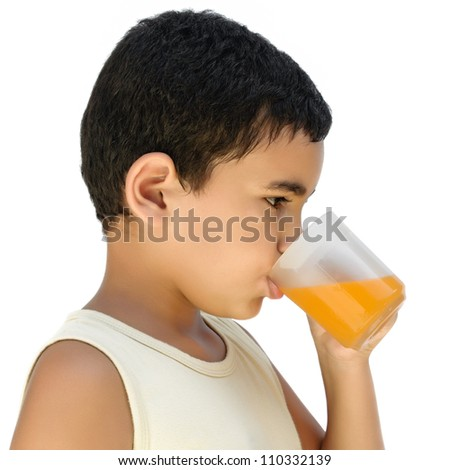 A very thirsty latin boy drinking a cold fruit juice isolated on white - stock photo