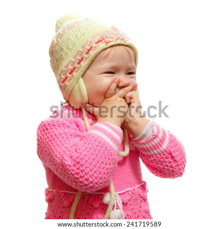 A very young blond female baby laughing - stock photo