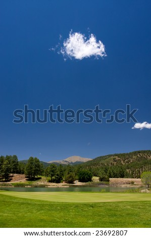 A vibrant image of a golf hole in Arizona - stock photo