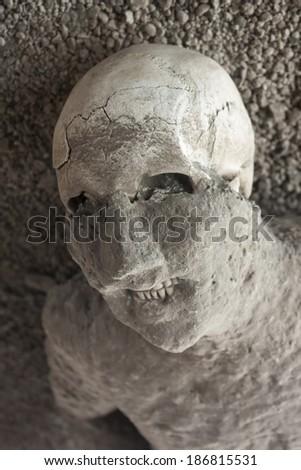 A victim in Pompeii of the eruption of Mt Vesuvius in Roman times - stock photo