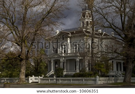 A victorian mansion in Autumn. - stock photo
