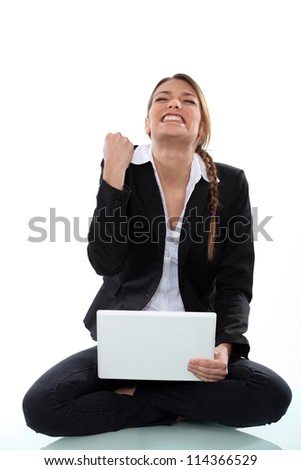 A victorious woman - stock photo