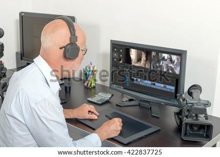 a video editor in his studio - stock photo