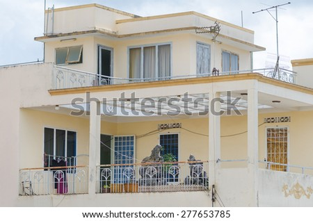 a Vietnamese beige house with spacious terraces - stock photo