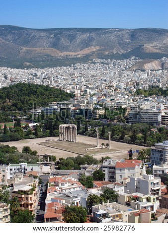 A view across Athens showing the modern city against ancient ruins - stock photo