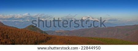 A view across the valley of the snow capped mountain range