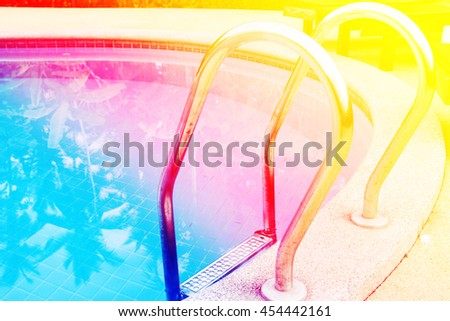 A view clear blue swimming pool with steel ladder. - stock photo
