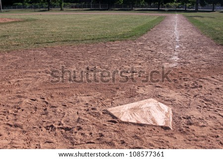 A view down the right field line of a baseball field shot from home plate.