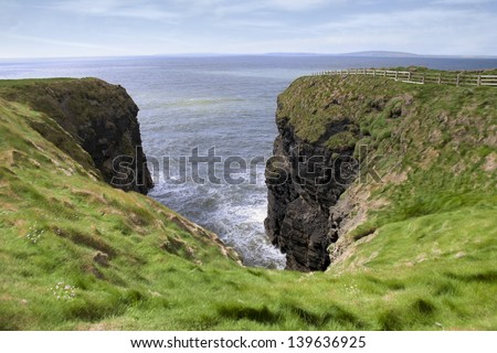 a view from a cliff walk on the top of the cliffs in Ballybunion county Kerry Ireland - stock photo