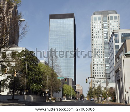 A view from Downtown Birmingham, AL showing two tall bank buildings. - stock photo