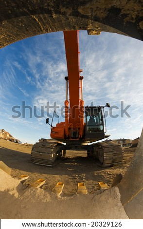 A view from inside the bucket of a backhoe - stock photo