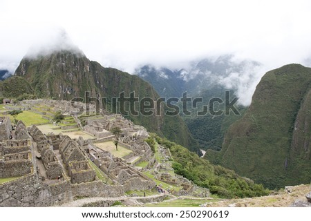 A view from Machu Picchu on a cloudy day. - stock photo
